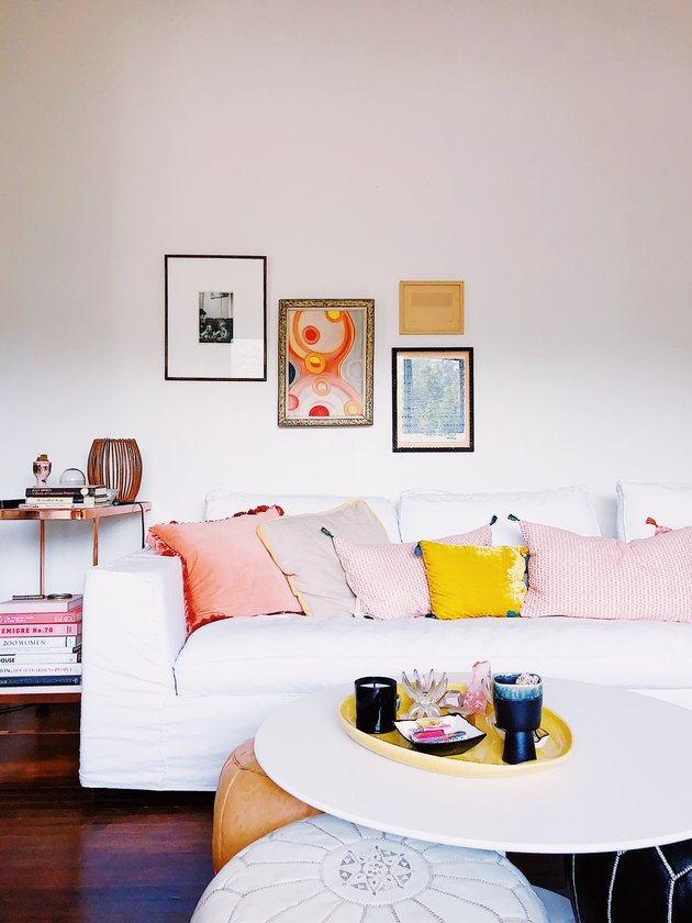 SF Girl by Bay Victoria Smith living room with white sofa and floor poufs