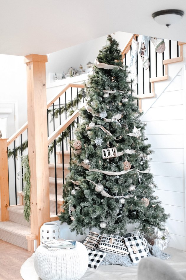 Modern  farmhouse Christmas decorating idea with tree with ornaments and wrapped gifts