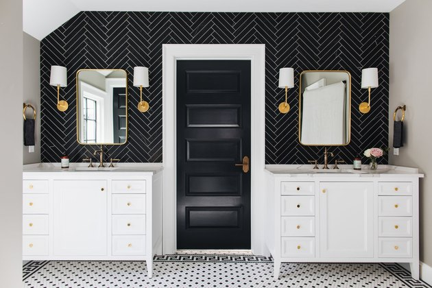 Black bathroom backsplash idea with herringbone tile