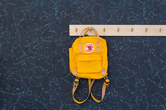 constellation wallpaper with yellow backpack