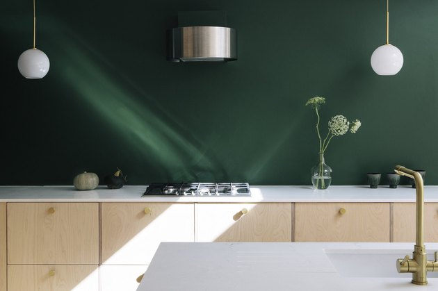modern kitchen cabinet idea with plywood and emerald green wall