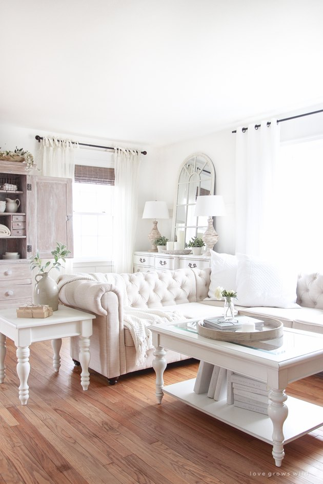 feminine farmhouse-style living room with window-frame mirror
