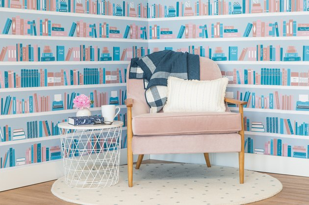 book shelf-inspired wallpaper with chair