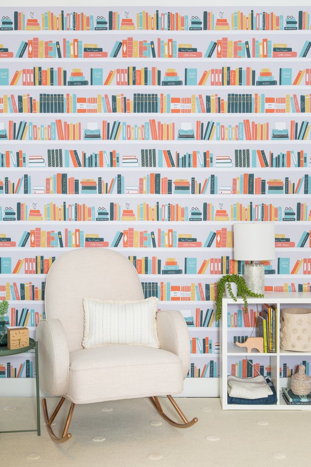 bookshelf-themed wallpaper with chair