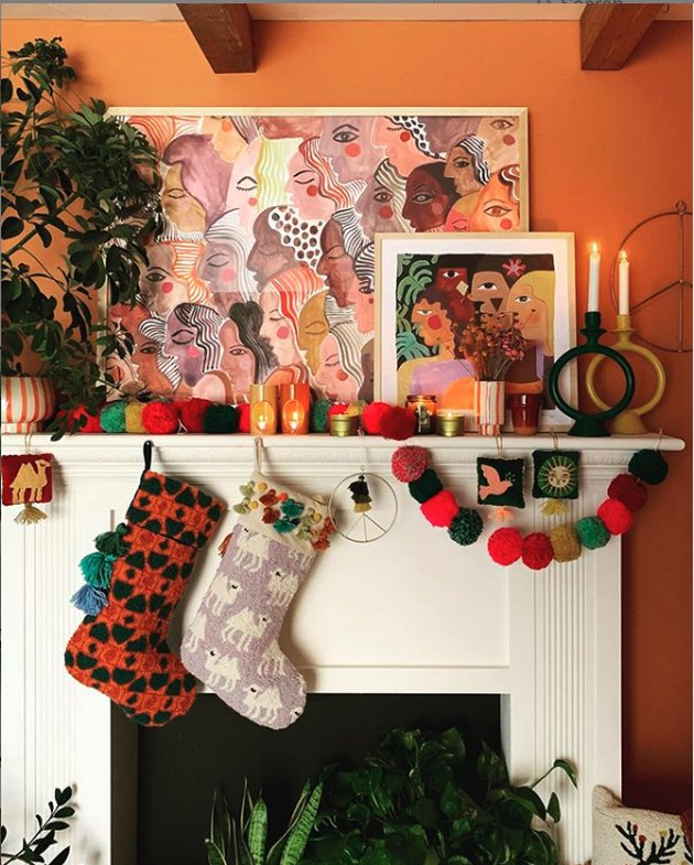holiday mantle with stocking and pom pom garland