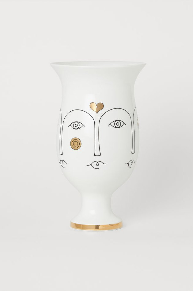 porcelain vase with face pattern