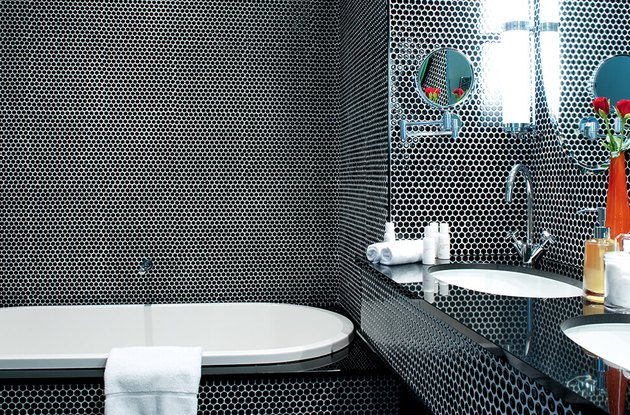 Black bathroom backsplash idea with floor to ceiling penny round tile