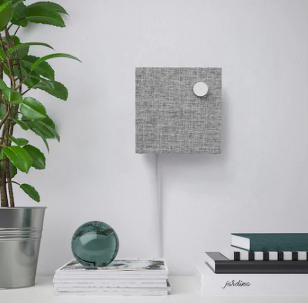 gray bluetooth speaker on wall
