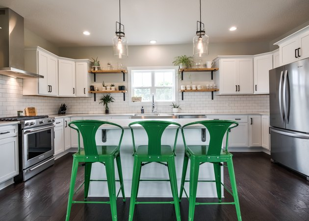 kitchen with green bar stools