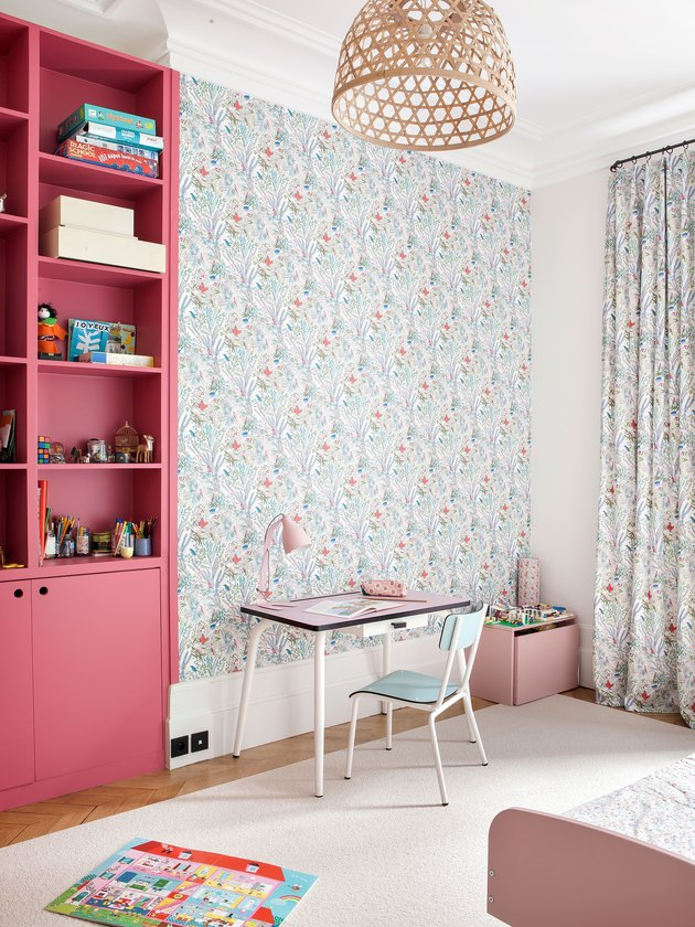 little girl's bedroom with wallpaper