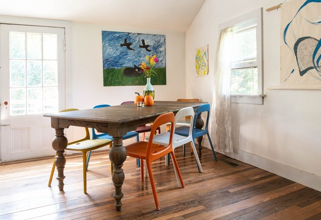 dining room with hardwood floor and modern art