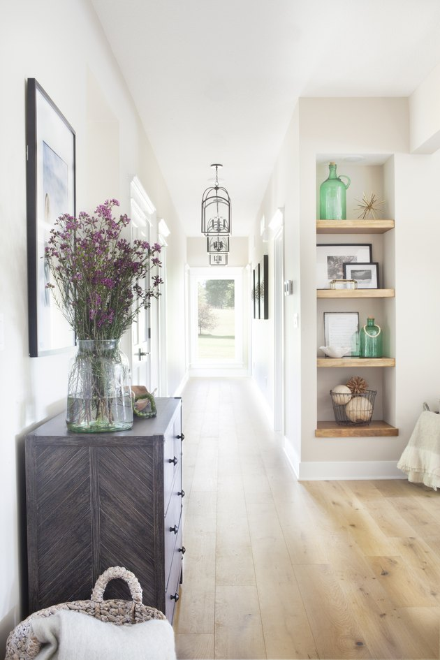 vintage farmhouse decorating idea at entryway with weathered woods and light finishes