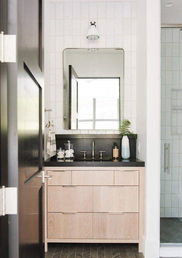 Bathroom backsplash idea with dark gray to match countertop