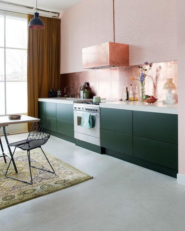 pink kitchen with green cabinets and concrete countertops