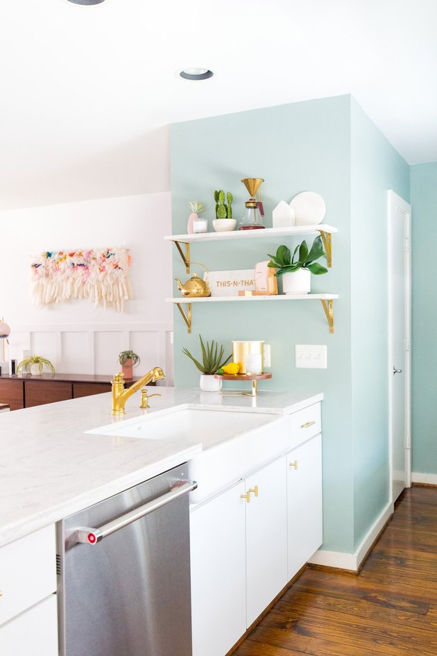 white and mint green kitchen with open shelving and farmhouse sink