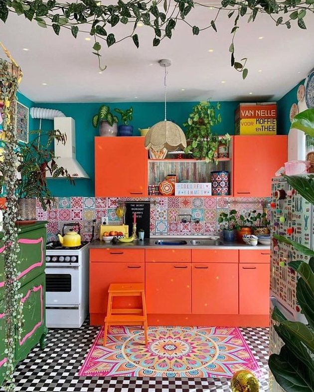 orange kitchen color idea with teal walls and patterned floor tile and backsplash tile
