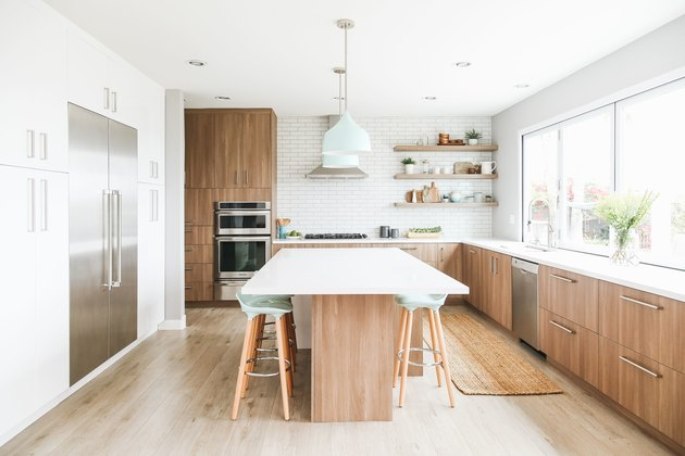 mint green kitchen idea with wood cabinets and mint accents