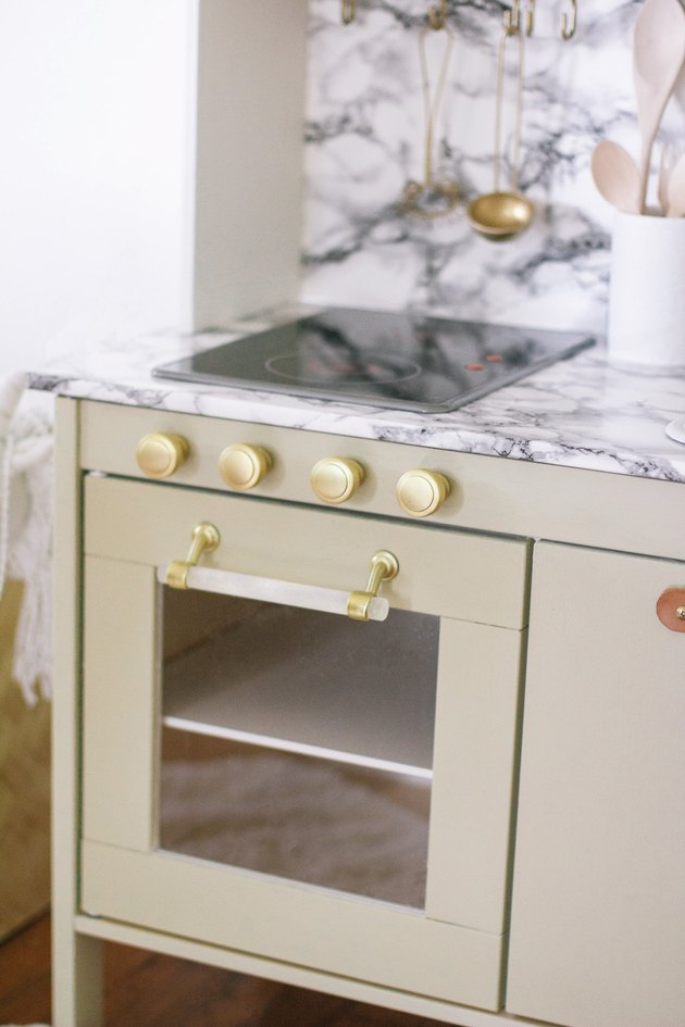 Stove and Oven gold hardware