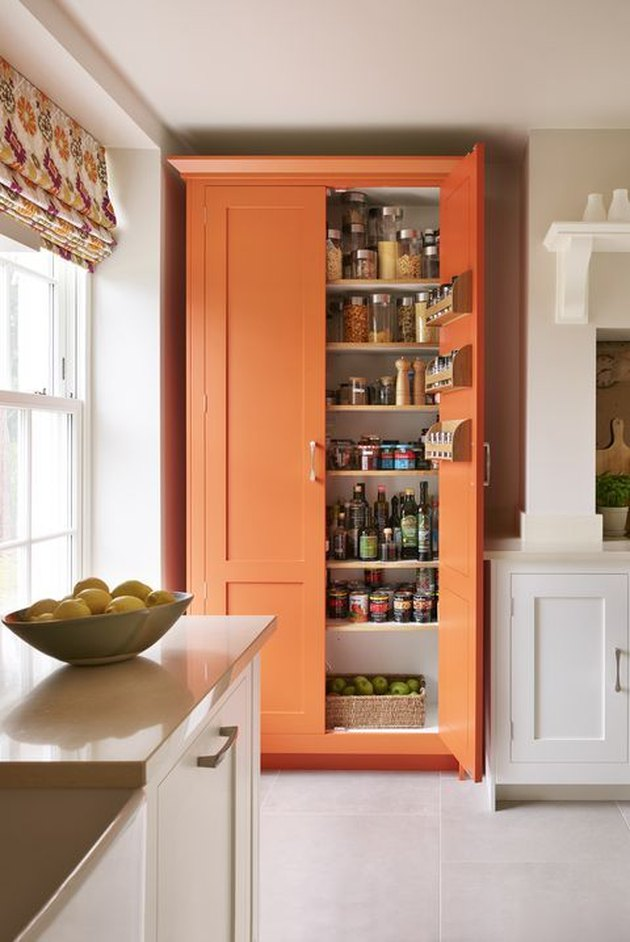 orange kitchen color idea with white shaker cabinets and orange pantry closet