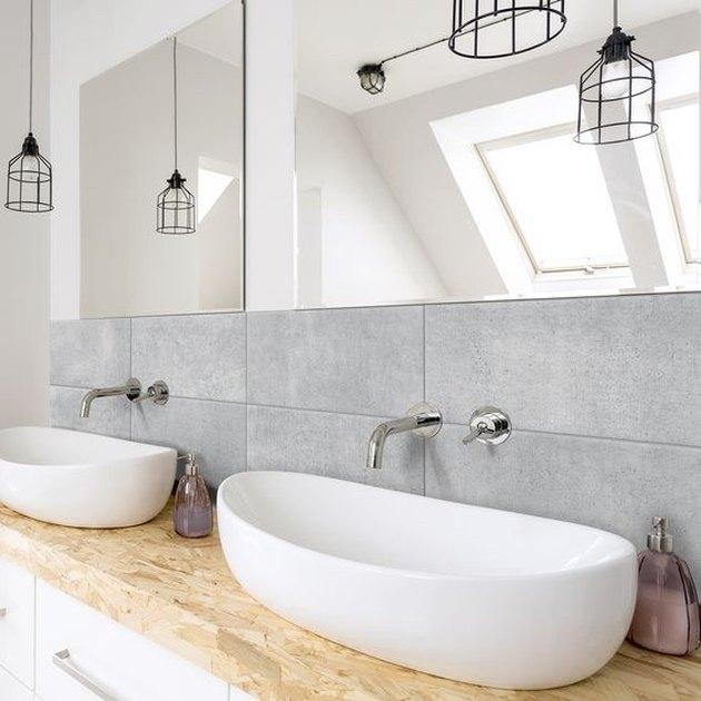 bathroom backsplash idea with oversize tile behind vessel sinks