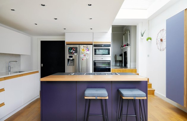 purple kitchen color idea with wooden countertops and stainless steel appliances
