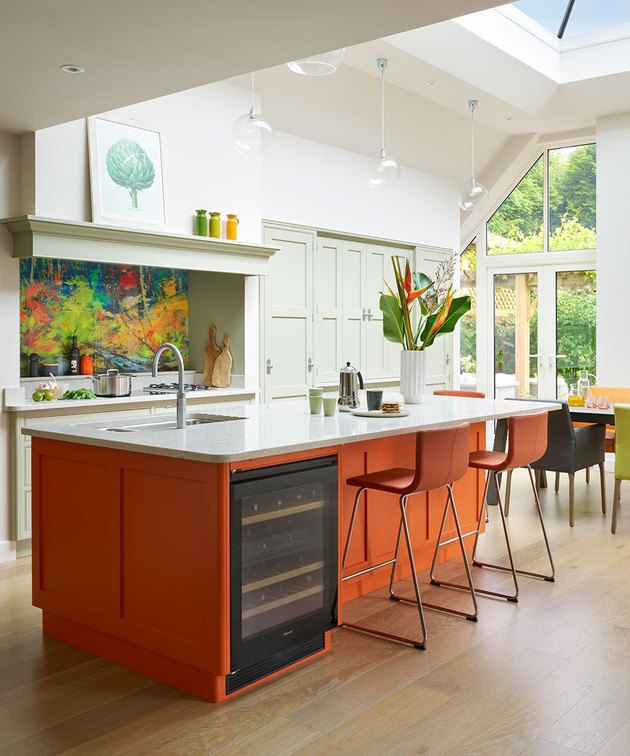 contemporary orange kitchen color idea with orange island and bar stools