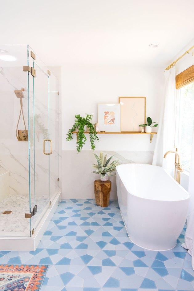 gray bathroom backsplash idea with marble behind freestanding bathtub