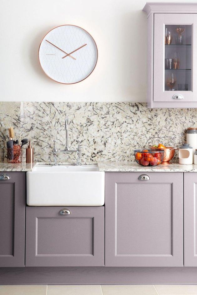 purple kitchen color idea with marble backsplash and farmhouse sink