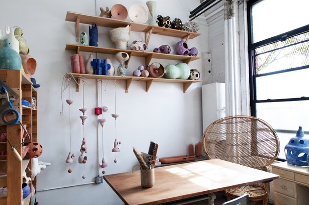 studio space with wood table and wooden shelves