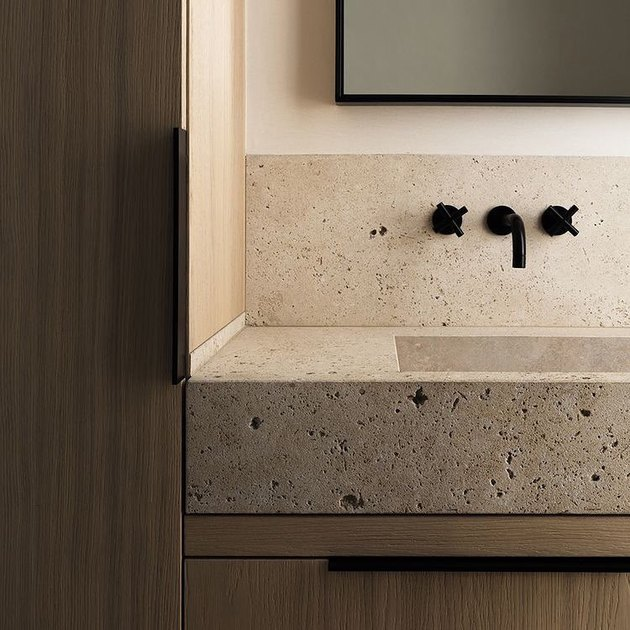 Travertine sink and backsplash in modern bathroom