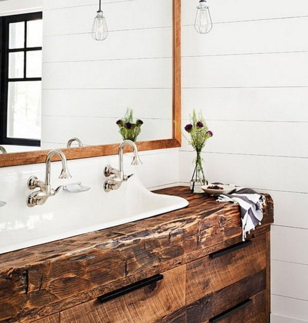 Shiplap and reclaimed wood tie this vanity and backsplash together forever.