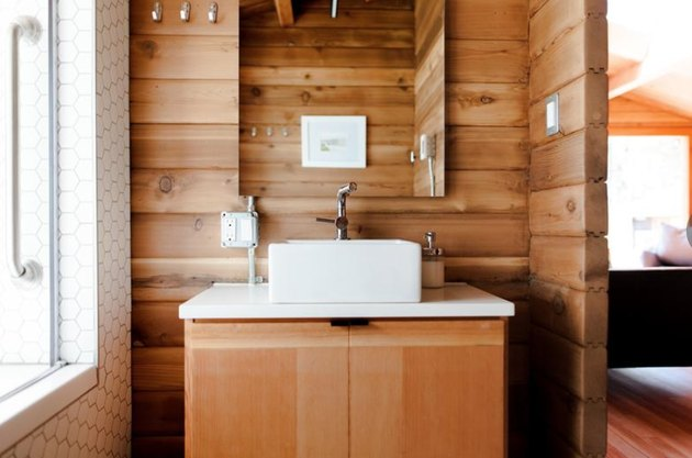 This cabin in Canada has some local wood used as a backsplash.