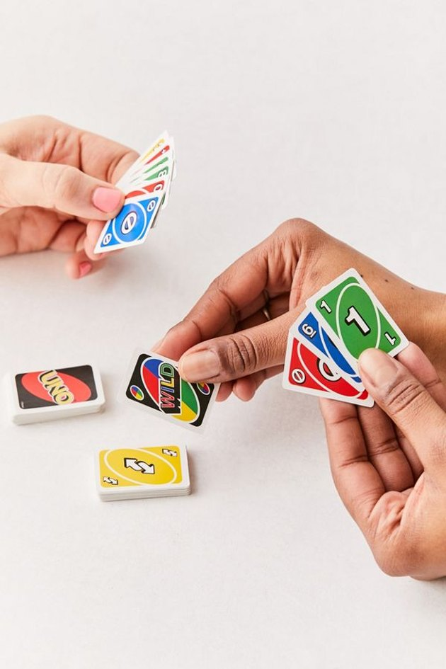 people playing mini uno game