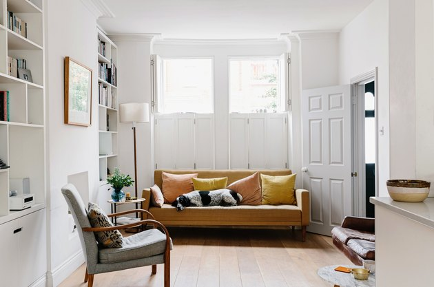 living room space with mustard couch
