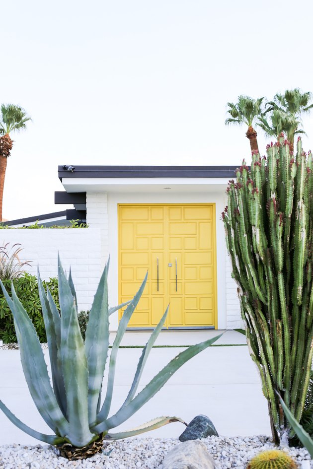 Yellow midcentury modern front door with square shapes and cacti