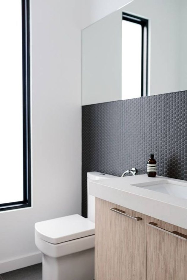 penny tile bathroom backsplash idea with black tile and black grout