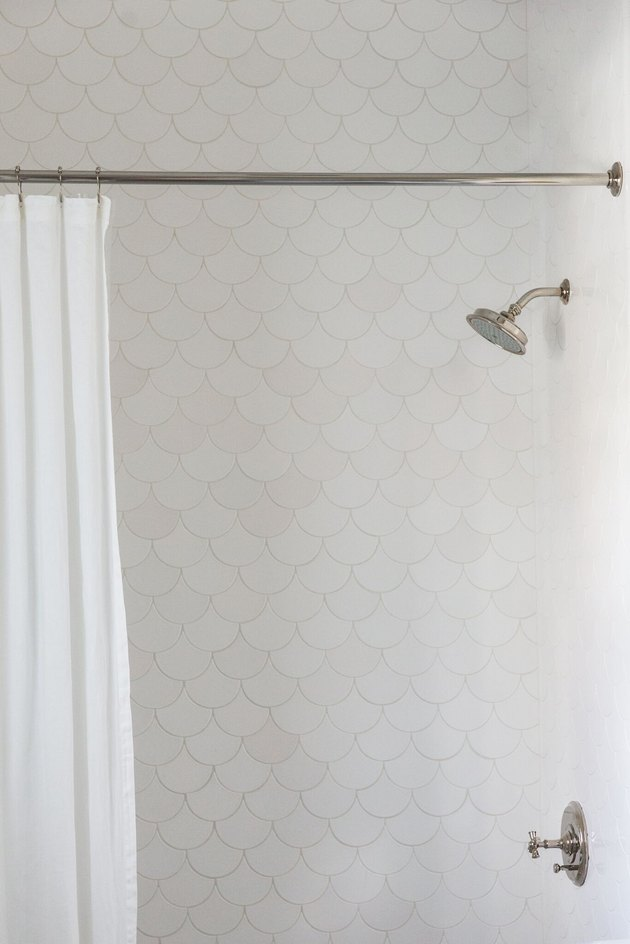 white scalloped shower tile