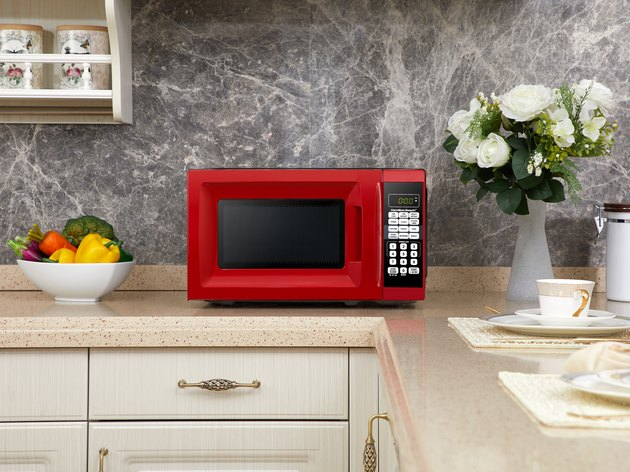 red Hamilton Beach microwave on kitchen counter