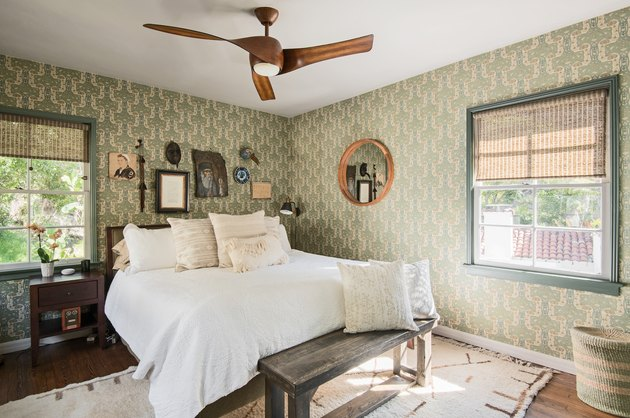 bedroom color idea with sage green patterned wallpaper and wooden ceiling fan