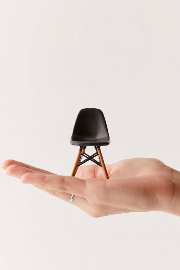 person holding mini chair