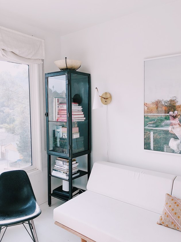 SF Girl by Bay office with vintage steel and glass display case from Chairish