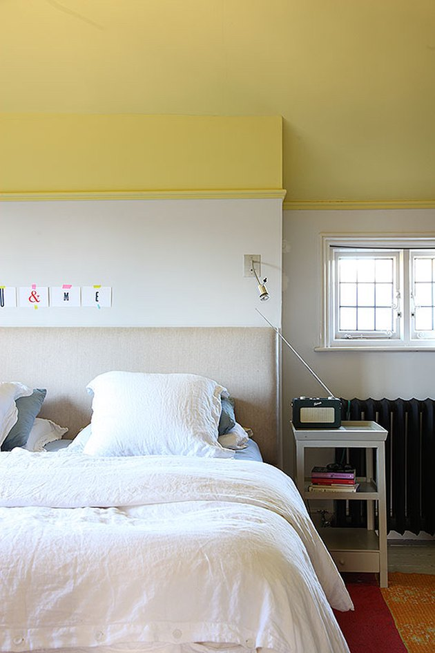 bedroom with yellow ceiling