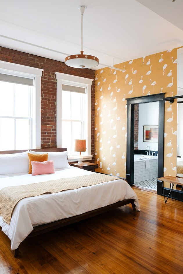 industrial bedroom with yellow wallpaper