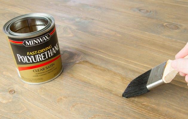 Polyurethane varnish being applied.