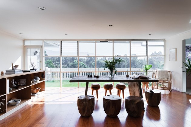 dining room with wood floors and floor to ceiling windows