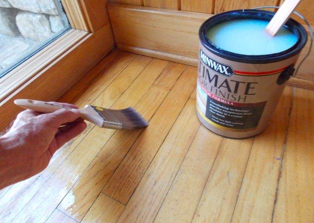 Floor varnish being applied.