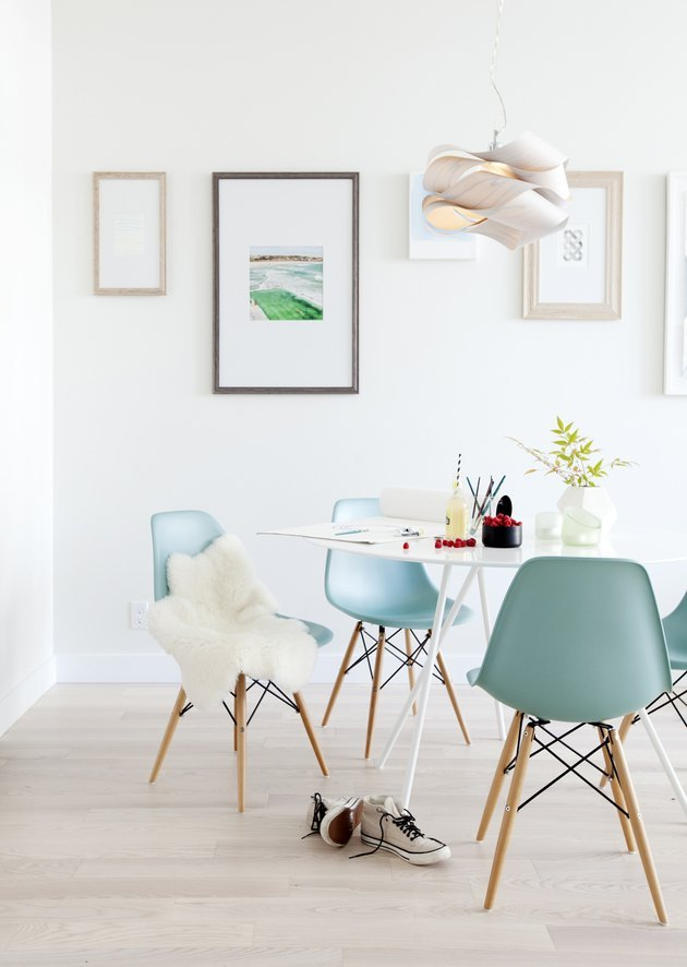 modern white dining room with blue chairs