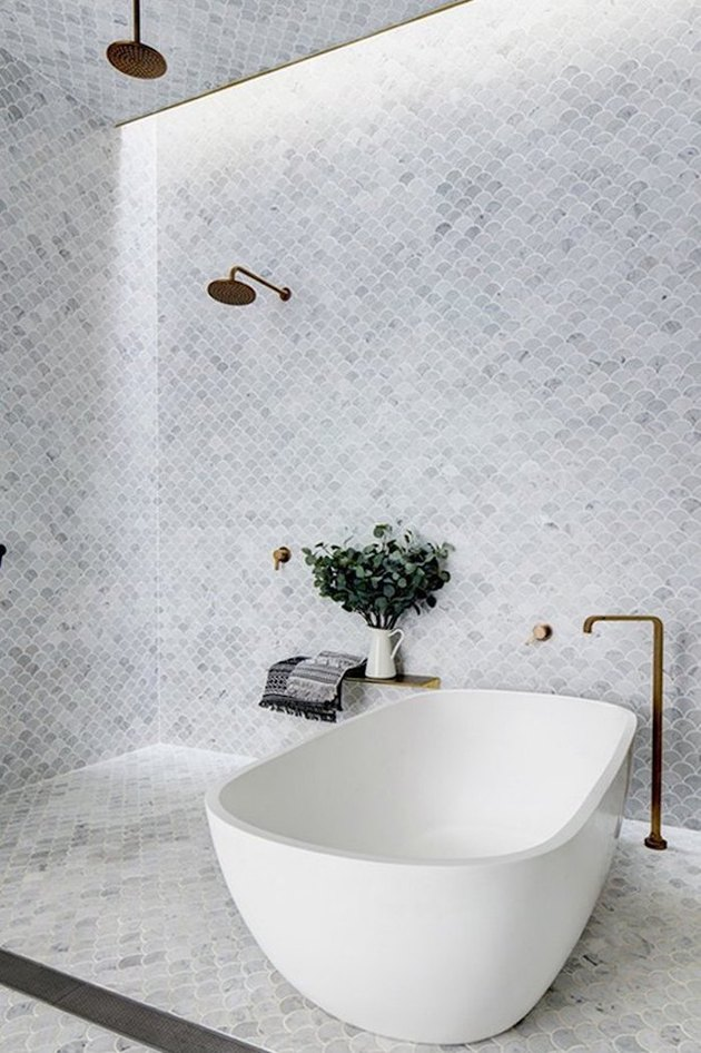 modern walk-in bathtub shower combination with mosaic tile wall and floor