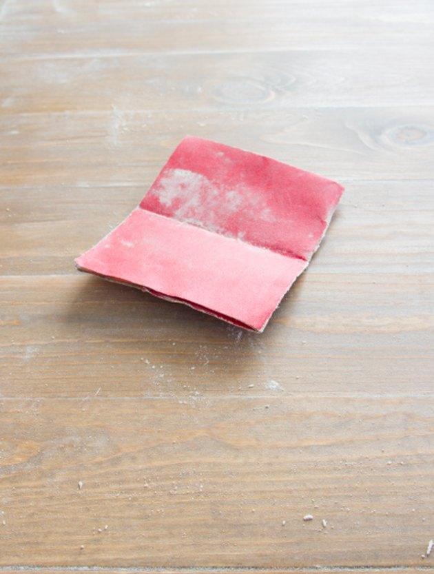 Sandpaper on finished wood.