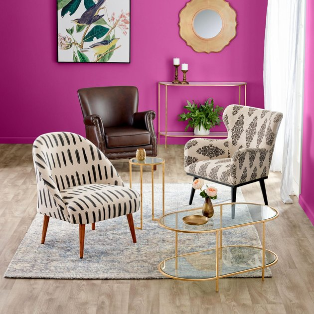 Fuchsia living room with bold pattern accent chairs